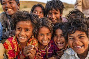 Group of happy Indian children - desert village, Thar Desert, Rajasthan, India.